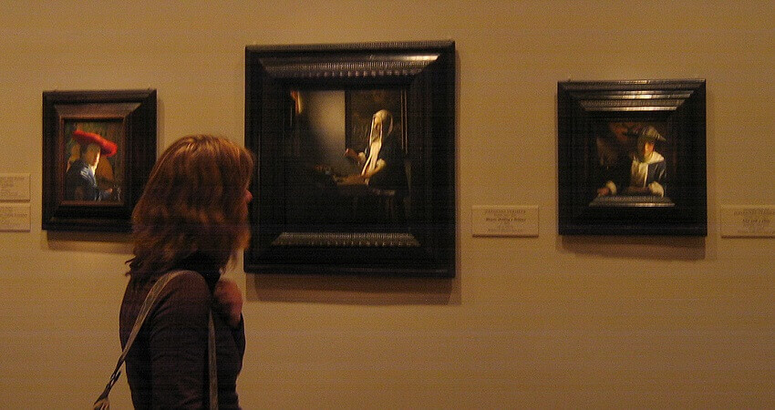 Photo of Woman Holding a Balance by Johannes Vermeer